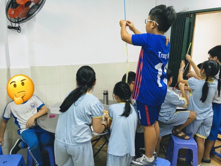 students building tower